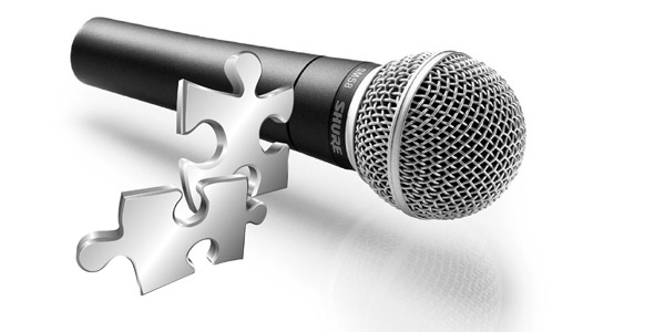 Microphone with puzzle pieces floating in front of it representing topics that could provide clarity for HR challengs